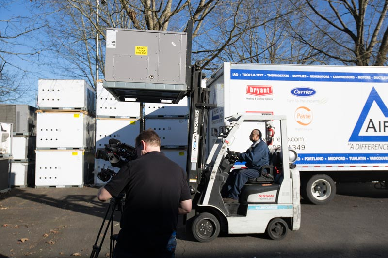 Airefco behind the scenes filming on location outside with a forklift and Airefco truck