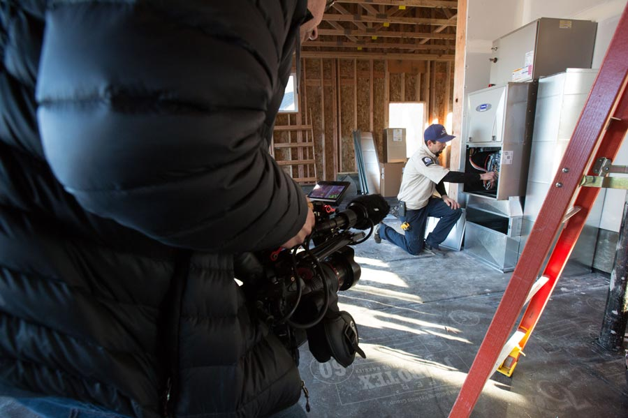 Airefco Carrier behind the scenes filming on location in a house being built with a Carrier install