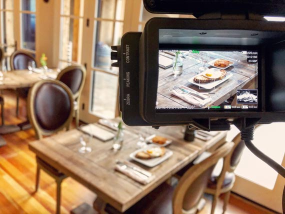 behind the camera screen filming a breakfast table at the Black Walnut Inn & Vineyard