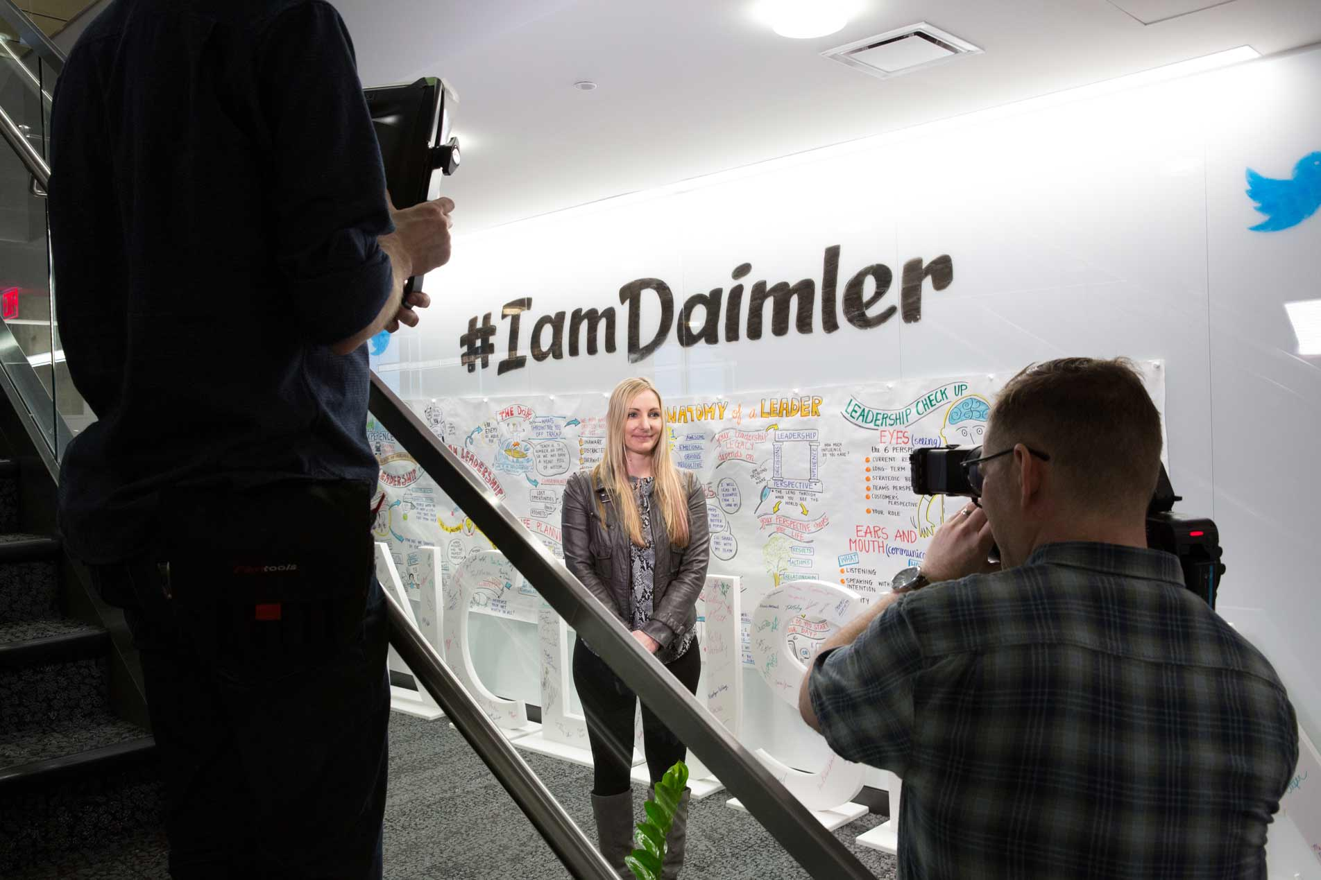 Daimler Diversity and Inclusion Behind the Scenes Filming a woman in front of the hashtag I am Daimler wall in Portland