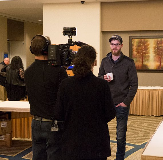 a camera crew interviewing a man at the airefco distributor event